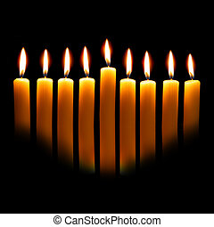 Hanukkah candles over black background with space for your...