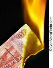 Russian rubles on fire - 5000 russian rubles bill on fire...