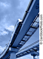 Monorail train - High speed monorail train on overpass toned...