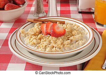 Oatmeal with strawberries - Bowl of oatmeal with...