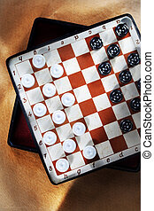 Travelling draughts on playing field