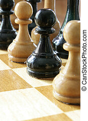 Coalition - Black and white chess pieces together, coalition...
