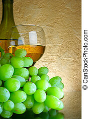 Bunch of grapes and white wine - Still-life with bunch of...