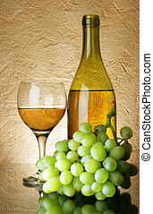 Grapes and white wine - Still-life with bunch of grapes and...