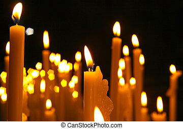 Close up view of the candles cutting through the darkness