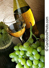 White wine and grapes - Bunch of grapes and white wine on...