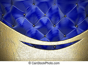 gold on fabric background - gold on blue fabric background