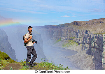 View of woman photographer. Iceland - View of woman...