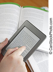 E-Book Reader - Man hands holding an electronic book reader...