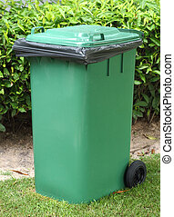 Green bin with black garbage bag