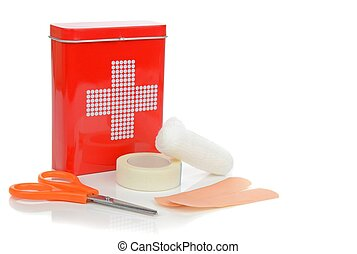 A Travel First Aid Kit - A travel first aid kit tin with...