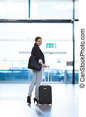 Pretty young female passenger at the airport