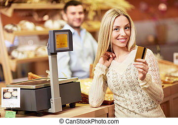 Finance - Attractive girl with a credit card