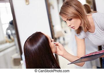 Make-up - Visagiste make-up girl in a beauty salon