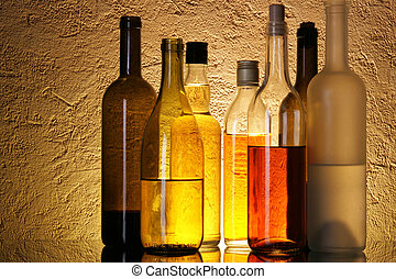 Bottles of alcoholic beverages over textured background