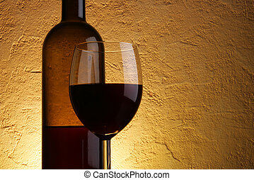 Wineglass and bottle of red wine with space for your text on...
