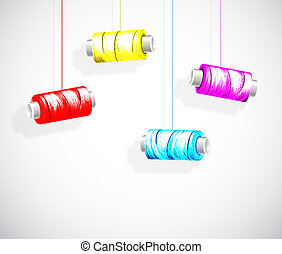 Bobbins of colorful thread - Hanging bobbins of colorful...