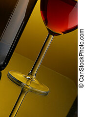 Glass of red wine and bottle close up