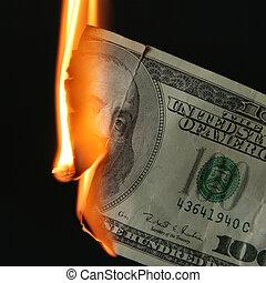 Dollars burn - Burning dollars close up over black...