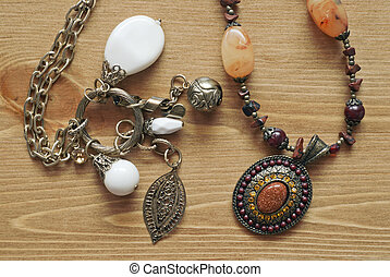 Necklaces on a wooden background