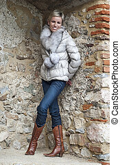Beautiful woman posing in brick niche - Beautiful smiling...