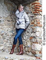 Slim woman posing in brick niche - Slim high woman posing in...