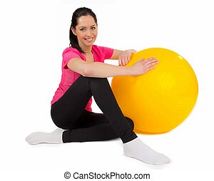 Happy young fitness woman with punch ball