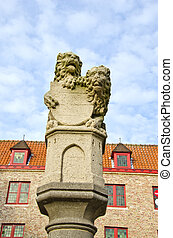 historical sculpture with two lions in Bruges,Belgium -...