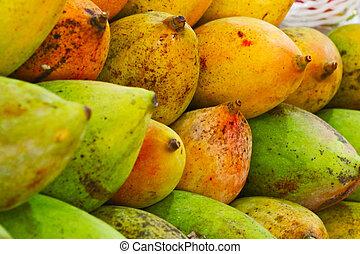 Close up of tasty mango on market stand, India