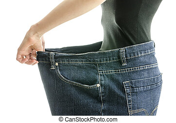 Successful weight loss concept - Side view of skinny woman...
