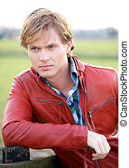 Male Fashion Model in Red Jacket - Portrait of a male...
