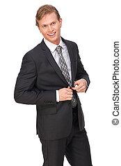 Businessman Buttoning Suit Jacket - Portrait of a...