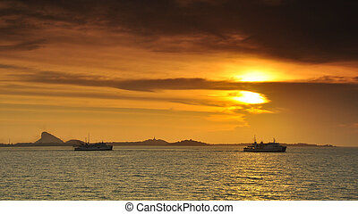 Ferry in the sea sunset