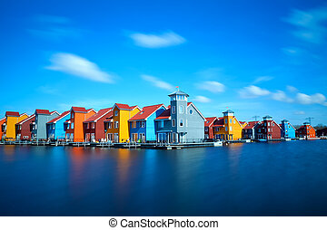 colorful buildings at Reitdiephaven on water in Groningen,...