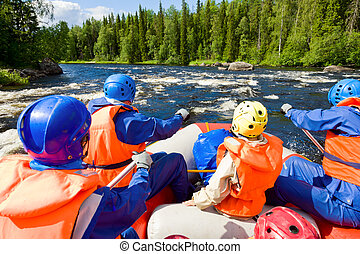 Whitewater rafting - Rafters in a rafting boat on Pistojoki...
