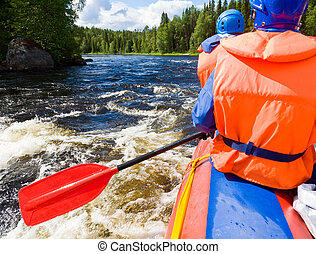 White water rafting - Rafters in a rafting boat on Pistojoki...