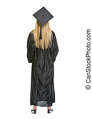 Full length portrait of woman in graduation gown . rear view
