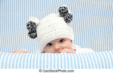 Baby with a knitted hat - Baby with a knitted white hat
