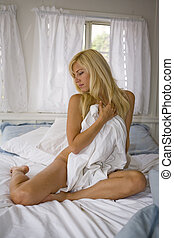 Nude Woman sitting in Bed - Nude Woman sitting on bed...