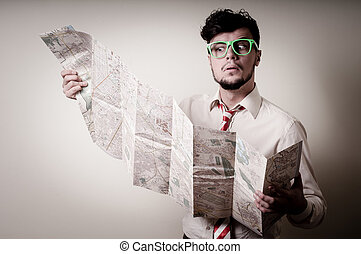 lost businessman with map on gray background