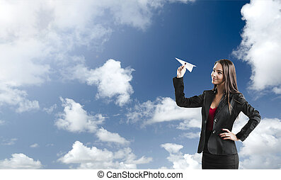 Business woman throwing a paper plane - Beautiful business...