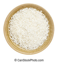 shredded coconut flakes in a small ceramic bowl isolated on...