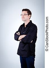 attractive adult man with glasses and black shirt