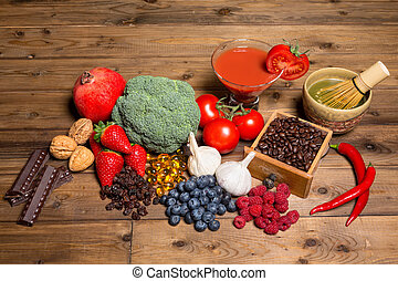 Fresh antioxidants - Fresh produce on a wooden table all...