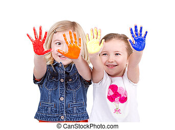 Two girls with paint on hands