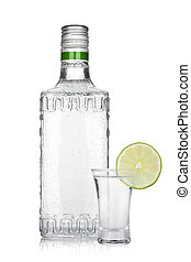 Bottle of silver tequila and shot with lime slice Isolated...