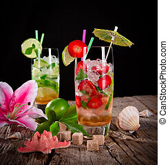 Cocktails over black background