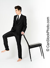 Young businessman with a office chair