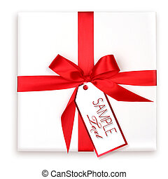 Pretty Wrapped Holiday Gift With Red Ribbon and Gift Tag -...