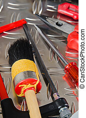 Set of working tools on a metal surface
